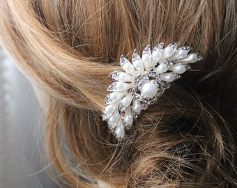 Beautiful silver color hair comb with sparkling rhinestones