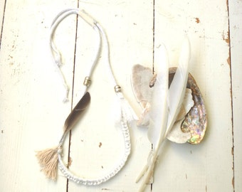 the kindness of doves #3 hand knotted and sewn rope necklace with feather, tassels and beads.  Individual no. 3