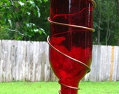 Wine Bottle Hummingbird Feeder With A Red Metal Flower Nozzle On Copper Tubing