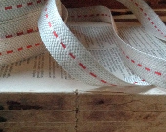 two yards of red stitched jute ribbon