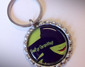 Wicked inspired Defy Gravity Bottlecap Keychain