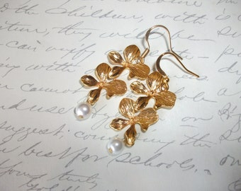Gold orchid flower earrings with pearl