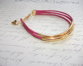Hot pink leather bracelet with gold tubes and heart charm