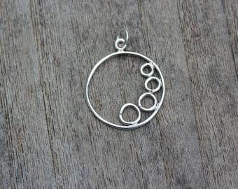 Sterling silver tumbling circles pendant