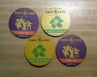 Pair of large upcycled beer coasters: Ommegang
