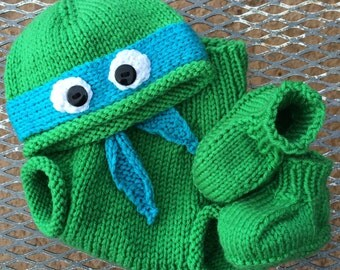Knitting Pattern For Ninja Turtles : Hand-knit teenage mutant ninja turtle hat with ribbed or