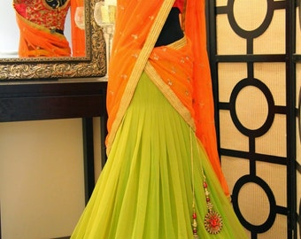 Green Lehenga with Orange duppatta and red blouse