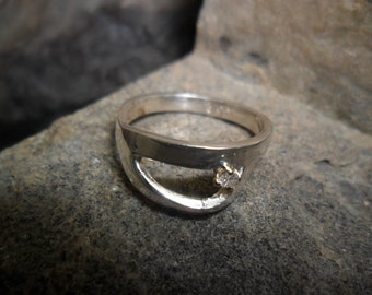 Sterling silver ring set with a diamond