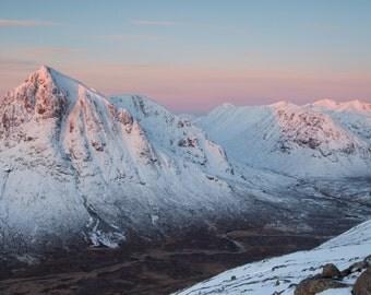 Sunrise over a snowy Glencoe, Scotland