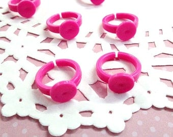 Children's ring, Hot Pink/ Magenta Plastic base with a 9mm glue pad,  size 3, A387