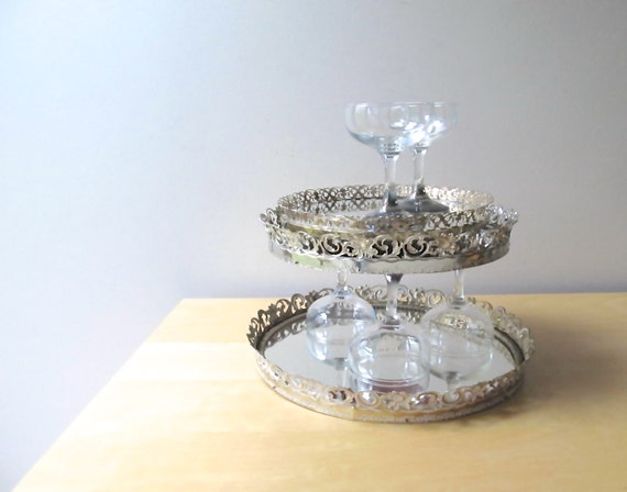 Silver and gold round vanity mirror trays tiered by ionesattic