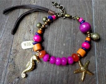 Sea bracelet, Ocean Jewelry, beach stamped bracelet, seahorse starfish charms, brass bells bohemian jewelry, fringe tassel, purple gemstone