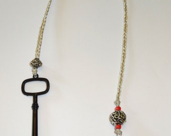 "Handmade Beaded ""Thong"" bookmark with black metal key"
