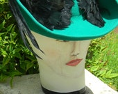This Jack McConnell emerald green hat is a classic beauty.  It is 100% wool with feathers.