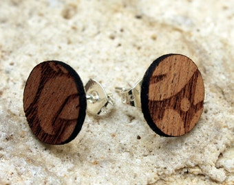Honolulu. Mahogany wood earrings are cut and engraved laser textured Honolulu.