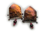 Post earrings in solid sterling silver with sunset colors patina and genuine garnet  One of a kind by Cathleen McLain