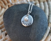 little circle with gemstone or charm . a customizable pewter soul mantra necklace