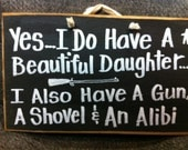 Have beautiful daughter gun shovel alibi sign wood