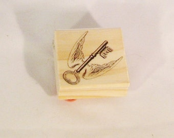 rubber stamp, wings, key, unused, 2 inch square, C, destash