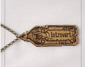 Introvert Pendant, engraved alder wood