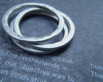 Three hammered sterling stacking rings set in brushed sterling made in your size