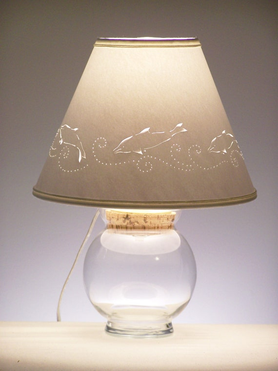 Items similar to small fillable lamp with dolphin cut