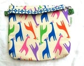 sofs offers a mid-size wristlet in soft girafs.