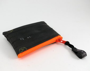 Recycled bicycle inner tube purse with neon orange zipper, top quality.