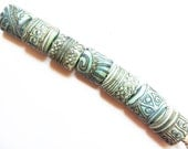 SILVERED COPPER TRIBE    7 copper green and silvered ivory matte finish nugggets   A Beaded Gift