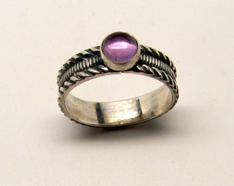 Sterlin silver stacking ring with amethyst gemstone.