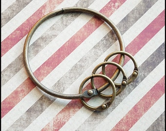 1 Big key ring with 3 small key rings Antique brass color