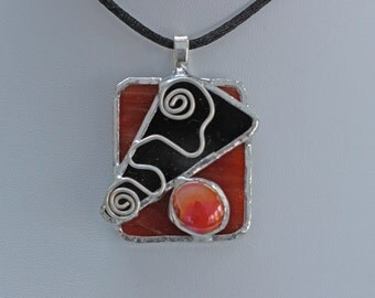 Handcrafted Abstract Design Stained Glass Pendant in Amber Glass with Black Accent