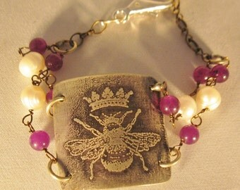 etched metal bee with crown bracelet