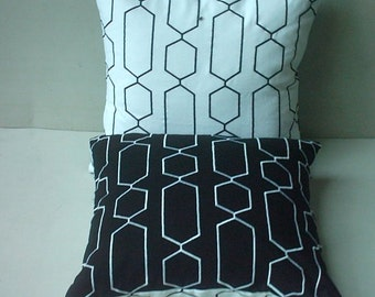 black geometrical  pillow . embroidery  in white  both sides reavars embroidery in  white on  black. 20  %  discount. 18inch