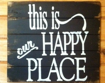 """This is our happy place 16""""w x 17 1/2""""h hand-painted wood sign"""