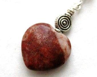 https://www.etsy.com/ie/listing/195433907/irish-jewelry-cork-red-marble-pendant?ref=listing-1