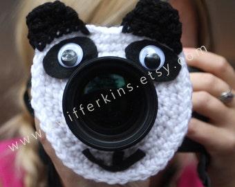 Camera lens buddy. Crochet lens critter panda bear. Photographer helper