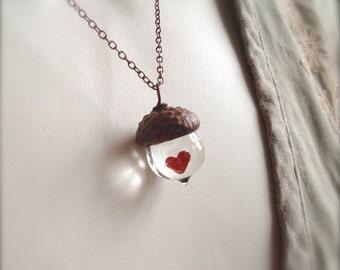 Mini Crystal clear Glass Acorn necklace with encased Heart by Bullseyebeads