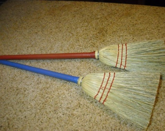 two child brooms-blueand red handles