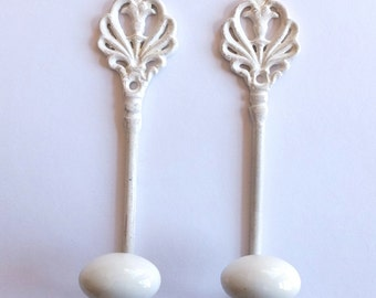 2 Hand Painted  Iron and Porcelain  Hooks
