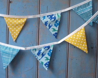 Small Classic Children's Bunting. Fabric Patterns - Animals, Cross Hatch, Spots. Colours -  Turquoise, Royal Blue, Teal and Yellow. 3m's..