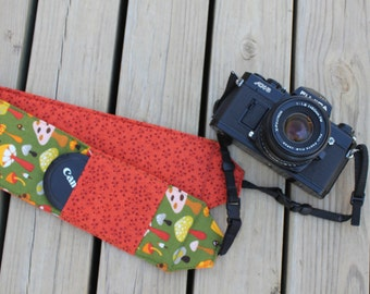 Monogramming included Wide Camera Strap for DSL camera 70's mucshroom print with dark orange reverse and lens cap pocket