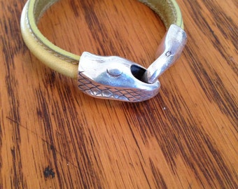 Chartreuse leather bracelet with silver snake hook closure.