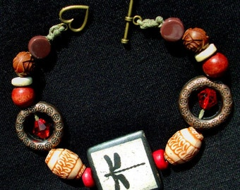 HOT Sale!  DRAGON FLY Bracelet - Earth tones, Hemp cord, wood and ceramic beads, red crystals, brass heart toggle, RedRobinArt