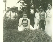 A Romp in the Hay Farm Girl Laying on Father's Back Straw Pile 1935 Farm Fun Vintage Black And White Photo Photograph