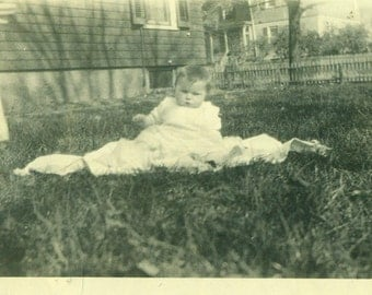 Spring Baby Sitting in the Grass on Blanket Unsure About Sitting 1920s Antique Vintage Black and White Photo Photograph