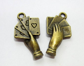 12 Antique bronze hand charms hand pendant gambling charms double sided 22mm x 11mm B 9264