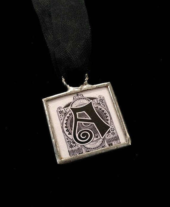 A initial monogram letter vintage aesthetic Victorian typeset necklace pendant on ribbon