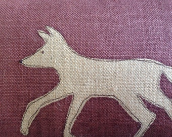 hand printed muted red little fox cushion