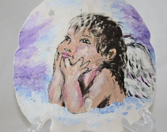 Angel painting on a seashell